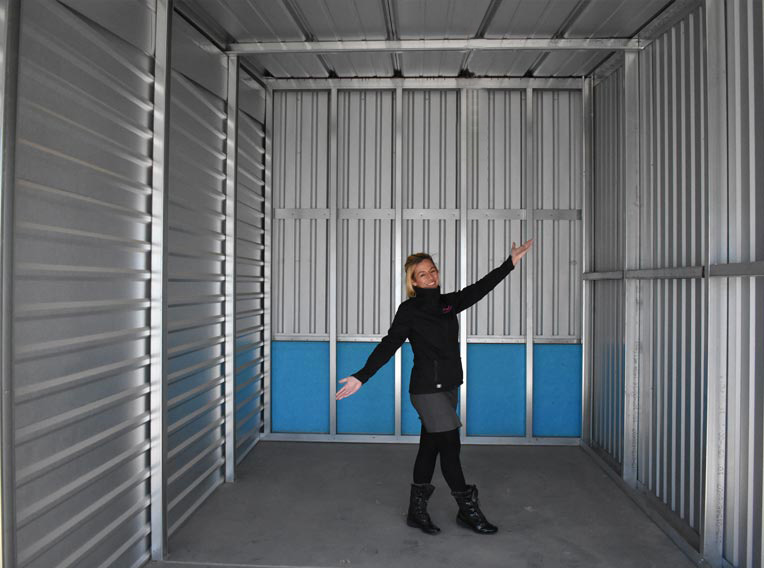 Woman standing in empty storage unit self storage near me storage for rent Intermountain Storage